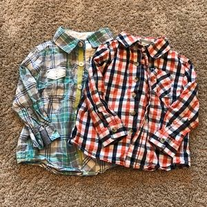two plaid button up shirts